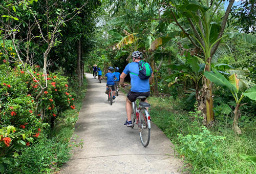Family cycling in the Mekong Delta region