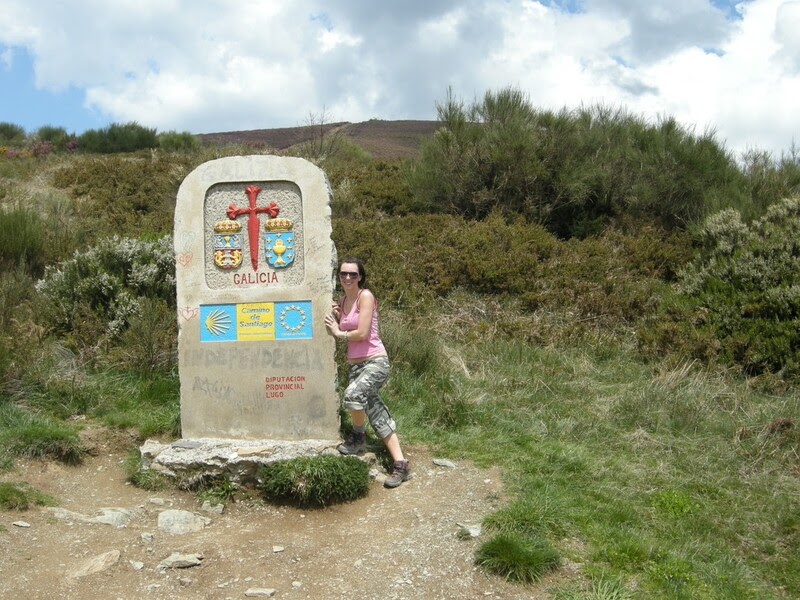 Brittany posing at the Galicia sign along the Camino