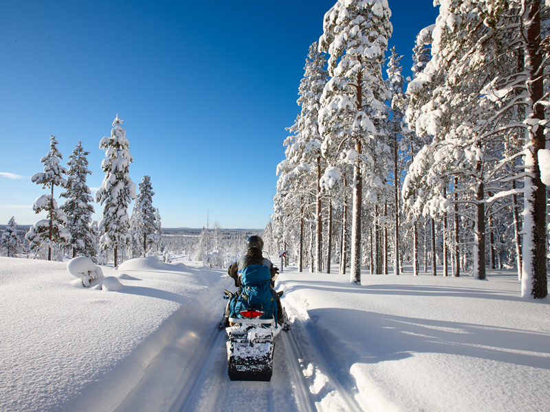 Family winter Snowmobiling in Finland